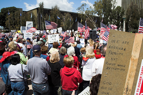 """The Santa Ana Tax Day Tea Party had a """"festival atmosphere that included performances by two members of the1970s pop band Bay City Rollersand a strolling Uncle Sam on stilts. […]"""