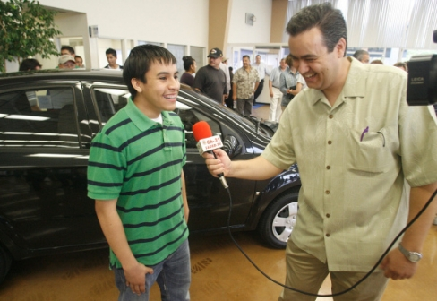 """Picture Courtesy of the O.C. Register Javier Zamorano, a student at Santa Ana's Middle College High School, won """"a shiny black Chevy Aveo with a price tag of $15,200,"""" for […]"""