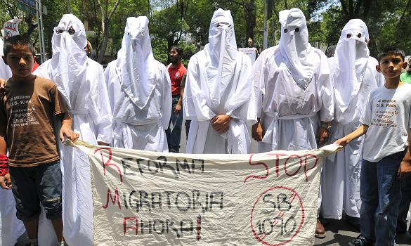 Demonstrators dressed as members of the Ku Klux Klan, protested outside the US Embassy in Mexico City against Arizona's immigration law, according to the Times Online.  Thousands marched in Phoenix...