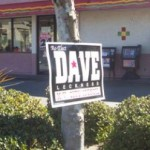 Dave Leckness nails his signs to trees