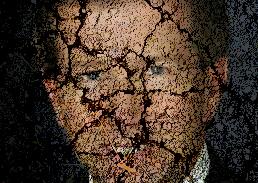 John Campbell image superimposed on cracked asphant