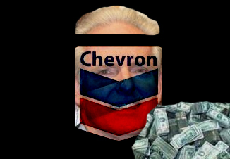 Tom Daly behind Chevron sign with one pile of money
