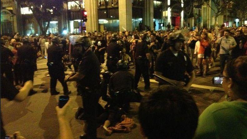 Police arrest people for chalking; surprised crowd flees