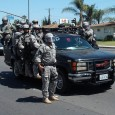 """SWATTING THE RABBLE: The Orange County Sheriff's Department SWAT team maintains constant surveillance of """"subversive groups"""" protesting against police brutality on the North side of Ball Road near Cambridge Street […]"""