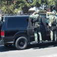 KEEPING THE RABBLE IN LINE: A member of West County SWAT, a regional Special Weapons and Tactics Team serving the cities of Cypress, Los Alamitos, Westminster and Fountain Valley, maintains...