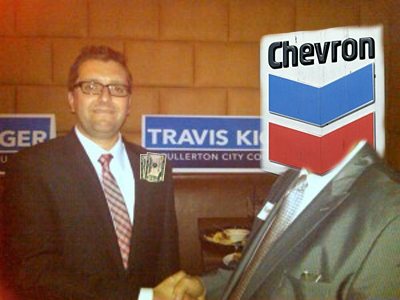 Travis Kiger and person with Chevron logo for a head