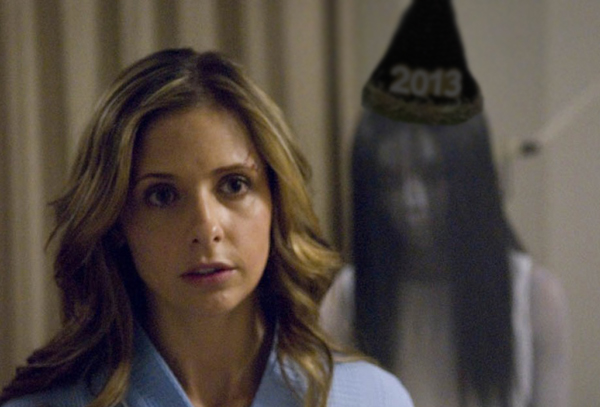 Still from the Grudge, with the ghost wearing a 2013 party hat.