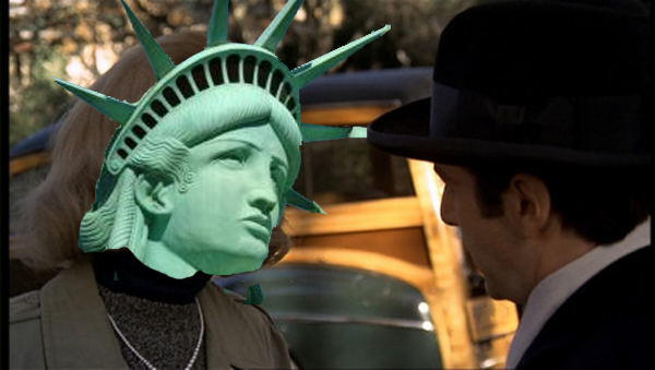Kay and Michael Corleone, with Statue of Liberty face and crown superimposed over Diane Keaton.
