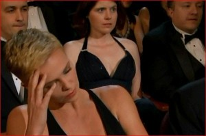 "Charlize Theron supposedly (but not really) reacting to the ""We Saw Your Boobs"" song."