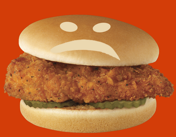 Chicken sandwich with sad face