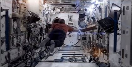 Space Station Commander Chris Hadfield picks up his guitar and leaves