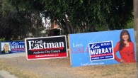 My wife and one of my daughters were driving north on Harbor Blvd. this weekend, between Sycamore and North, when they saw a collection of big candidate signs. You'll see...