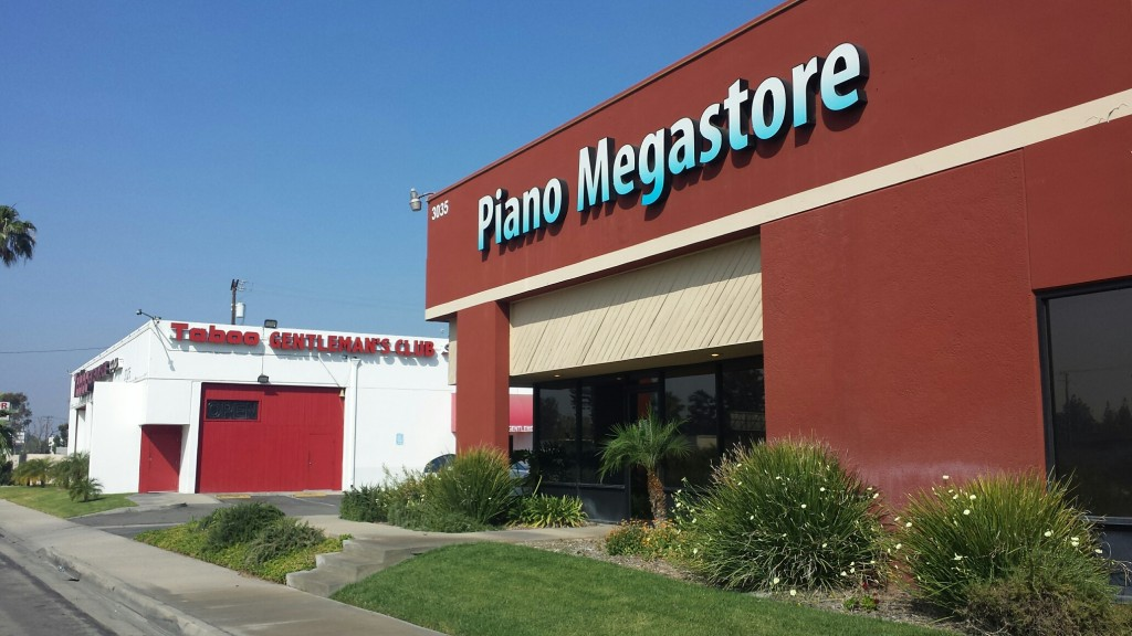 The closest businesses to the proposed site - piano store and strip club!