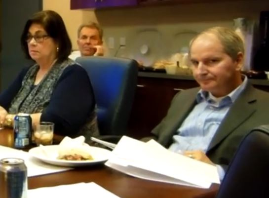 A displeased Denis Bilodeau to the right, flanked by a nonplussed Cathy Green and a noncommittal Phil Anthony.