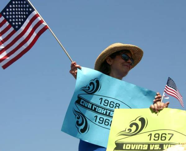 Louise Stewardson waving the flag for civil rights accomplishments at the Huntington Beach 4th of July parade.
