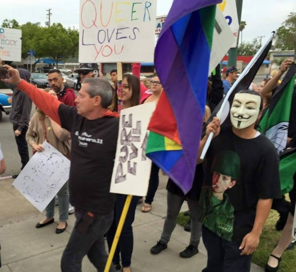 """Pro tip: Note that LeTourneau politely holstered his """"Pure Evil"""" sign until he was actually standing near a Westboro demonstrator."""