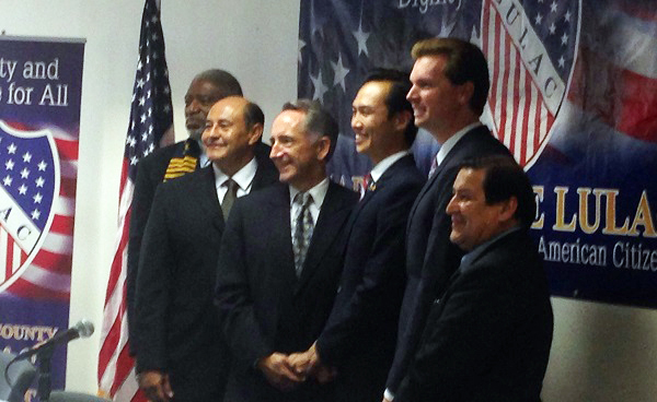 Bookended by OC NAACP Chair Donald Craig (at far left) and LULAC Chair Benny Diaz (at far right), the four candidates are: former State Sen. Lou Correa, former State Senator Joe Dunn, Garden Grove Mayor Bao Nguyen, and Anaheim Council member Jordan Brandman.