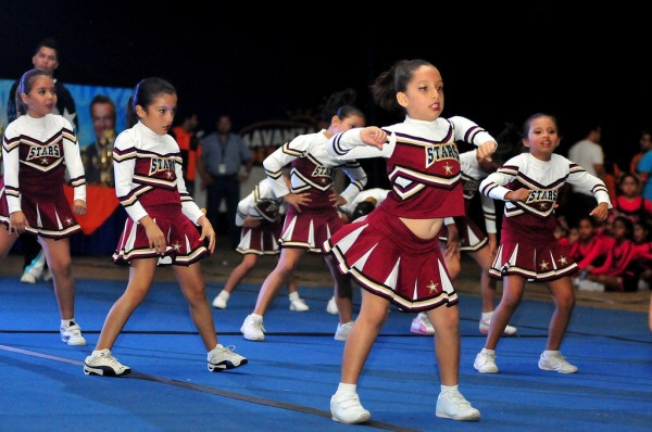 We were going to put up a photo of the Santa Ana Monarchs 2014 Pee Wee Cheer Team, but then we realized that if anyone objected we'd rather have offended strangers like the angry parents of these sweet young girls from Ecuador.