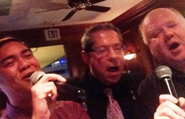 Mike, at right, at his last Democratic Party convention, doing that sweet karaoke with his friends (and my brothers in law) Oni and Jeff.