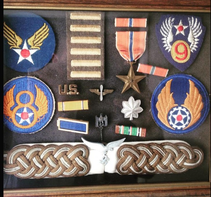 Luis Cardenas' award box. The lower epaulettes and pin are those of a Nazi. officer who was 10 minutes ahead of his unit. The Nazi's had taken over a French farmhouse. He was given orders to search out Nazi info before he was sent stateside. European African Middle Eastern Service Medal, American Theater Service Medal, American Defense Service Medal, World War II Victory Medal, Bronze Star Medal.