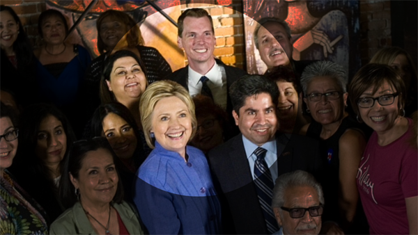Hillary Clinton visited Santa Ana and was spotted posing with Melahat Rafiei, Jordan Brandman, and Jose Solorio. Her advance person has presumably been fired.