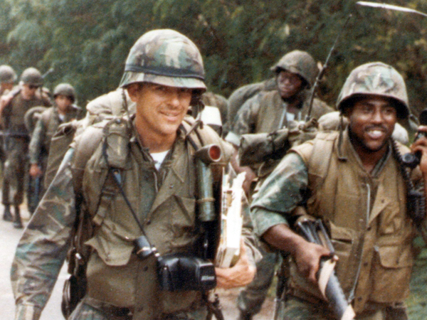 On this Veteran's Day holiday, who better to feature on our post but Marine Colonel Doug Applegate, closely pursuing Darrell Issa? (Not doing so in this photo, of course -- so far as we know.)