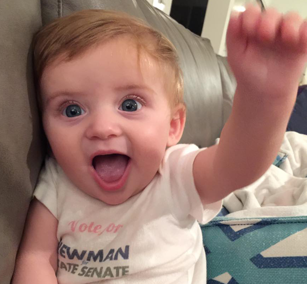 The photogenic Newman Cub courts controversy by flashing a Baby Power salute!